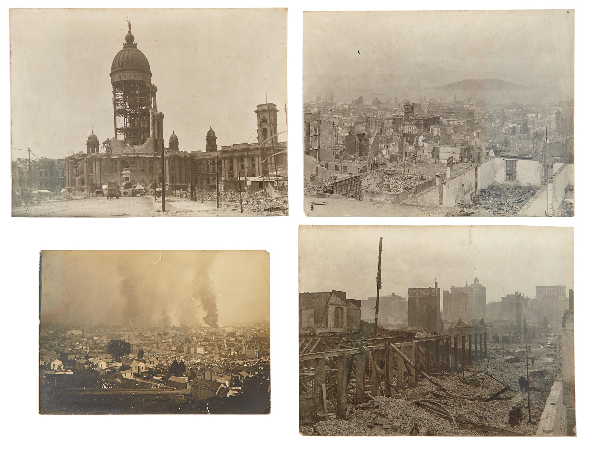 Lot image - [SAN FRANCISCO EARTHQUAKE]  Group of 20 photographs of the aftermath of the 1906 San Francisco earthquake and the resulting fire.