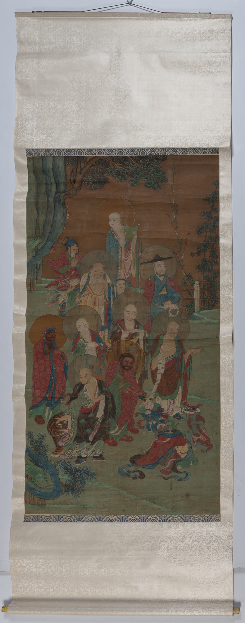 Lot image - A Large Chinese School Ink and Color Painting of an Assemblage of Luohan