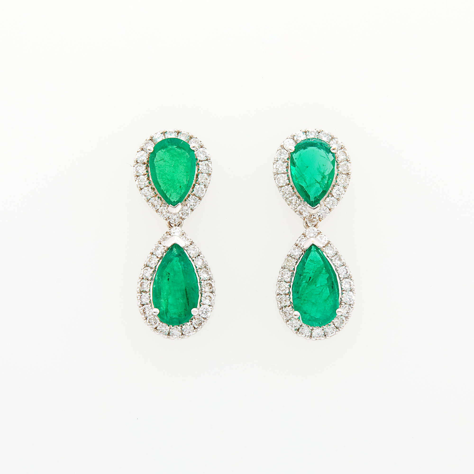 Lot image - Pair of White Gold, Diamond and Emerald Pendant-Earrings