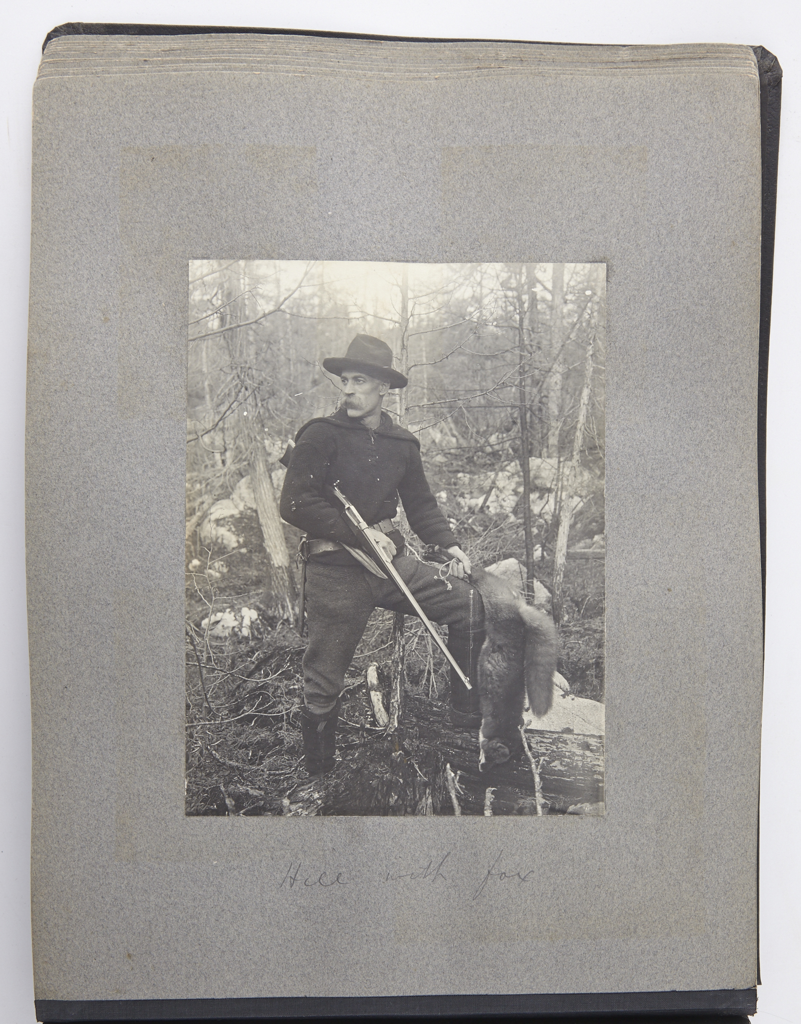 Lot image - [CANADA - HUNTING AND FISHING]  Photograph album depicting hunting, fishing, canoeing, and camping in Canada.
