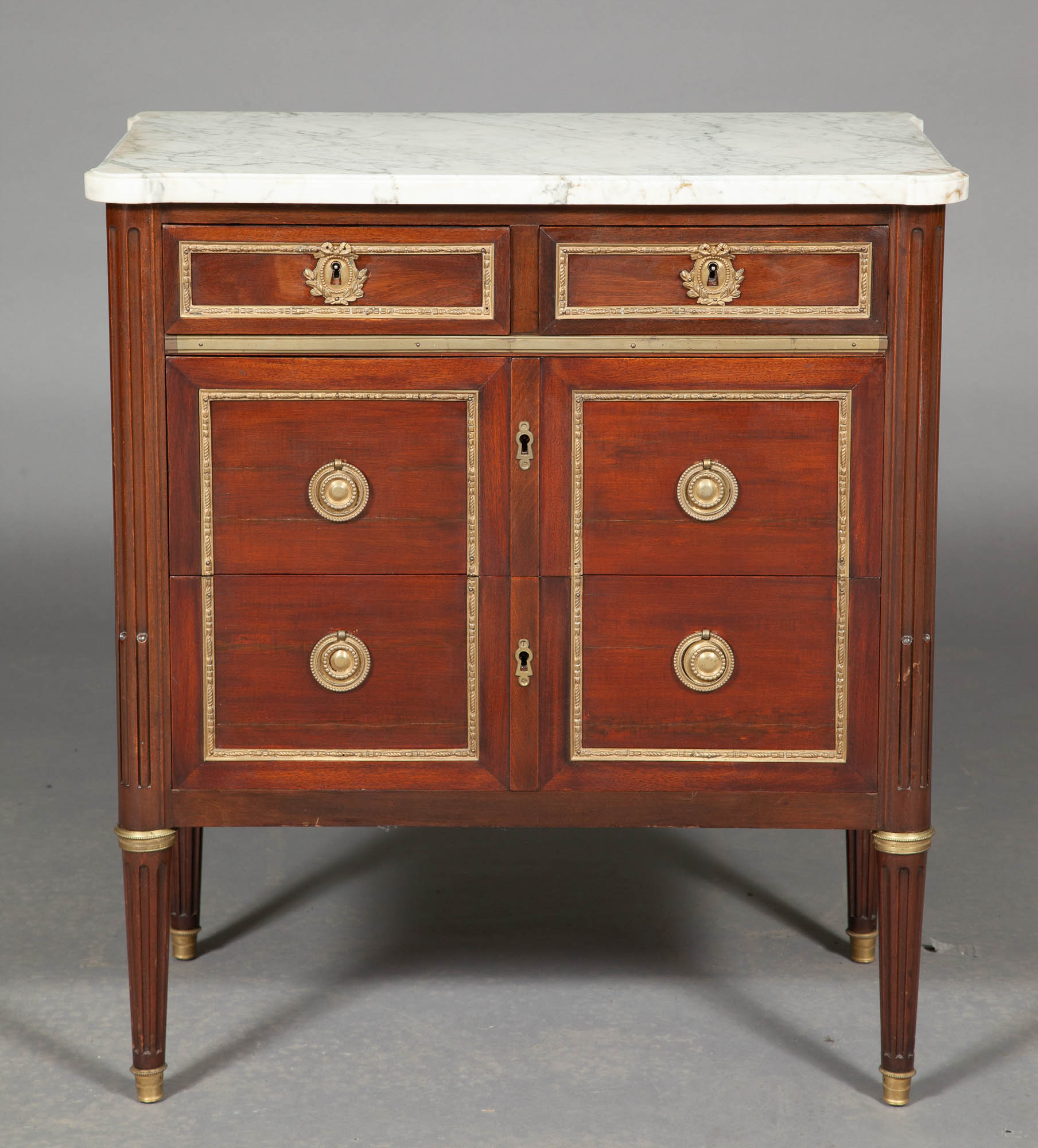 Lot image - Pair of Louis XVI Style Mahogany and Gilt-Metal Mounted Marble Top Small Commodes