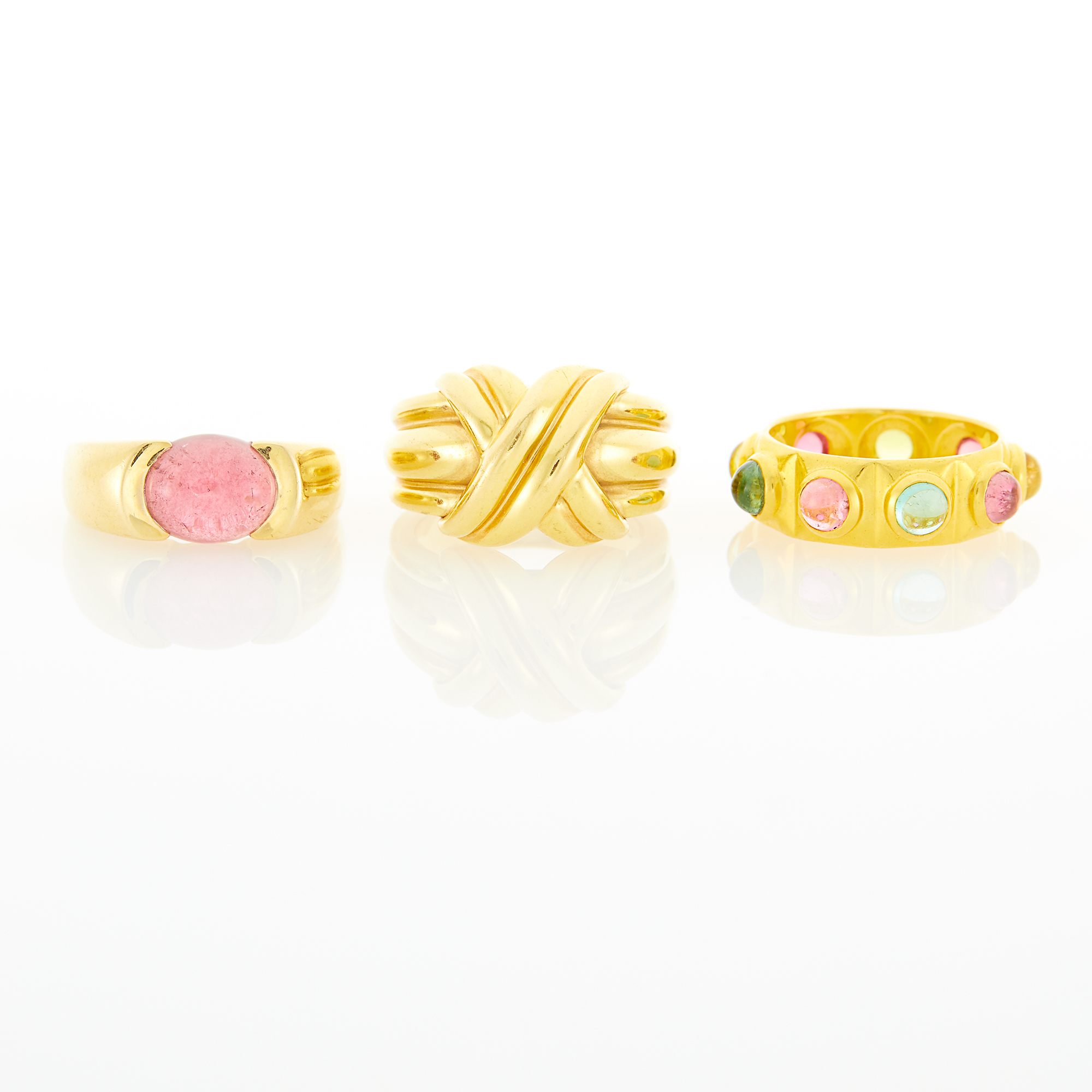 Lot image - Tiffany & Co. Gold X Ring, Gold and Cabochon Pink Tourmaline Ring and Gem-Set Band Ring