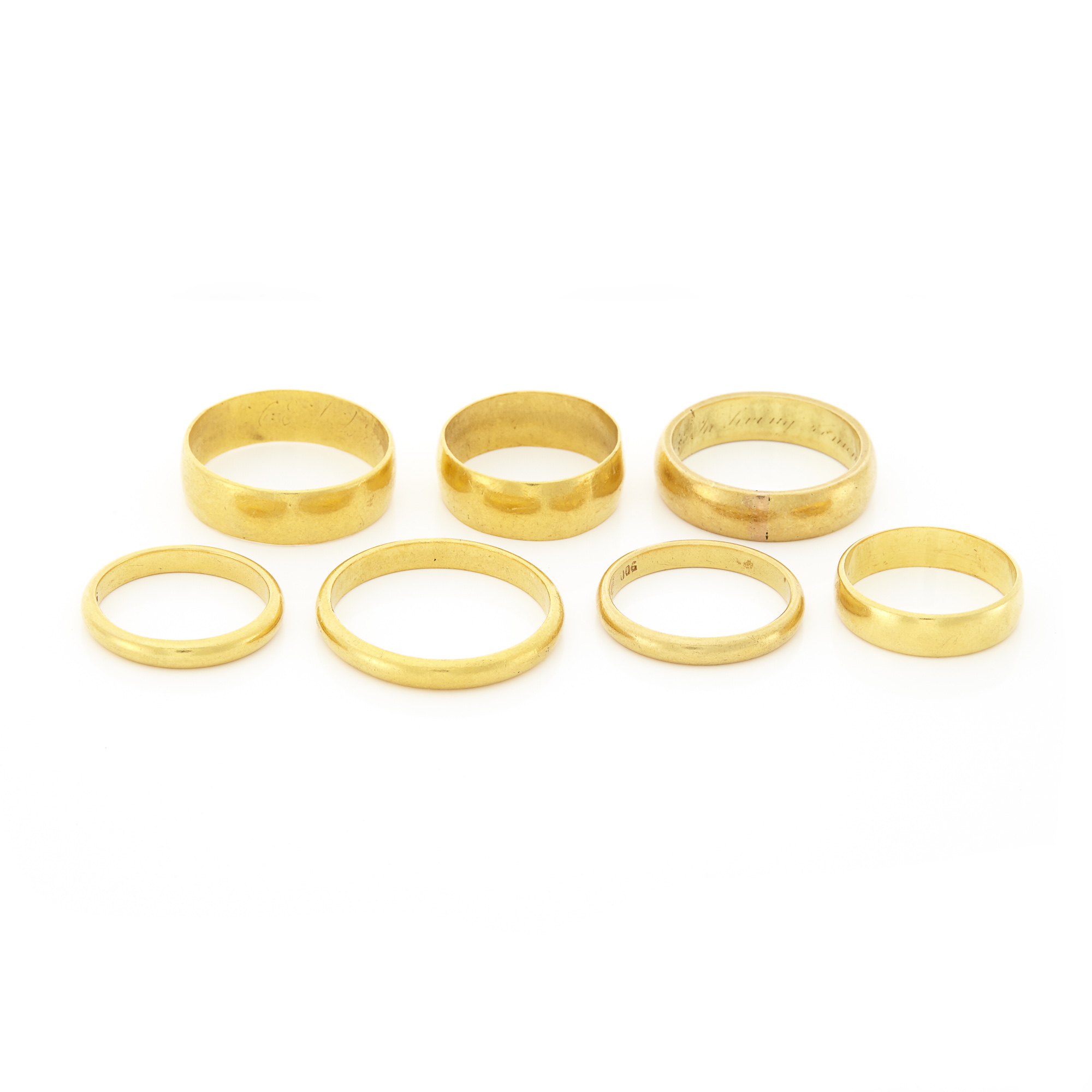 Lot image - Seven High Karat Gold and Gold Band Rings