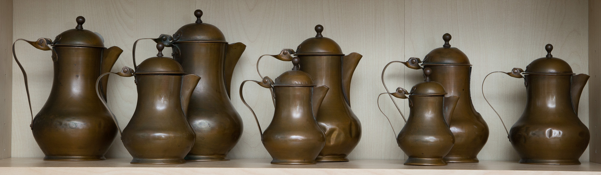 Lot image - Set of Eight Copper Covered Jugs