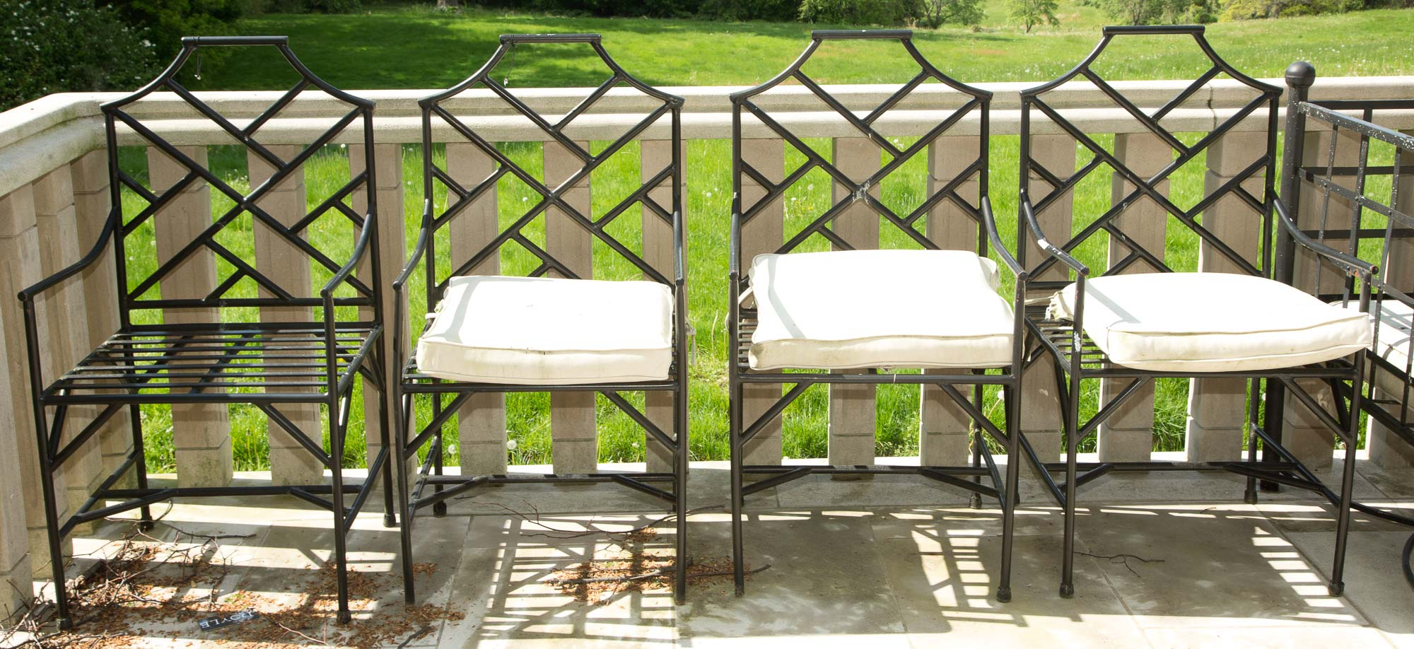 Lot image - Set of Seven Black Painted Metal Lattice Armchairs