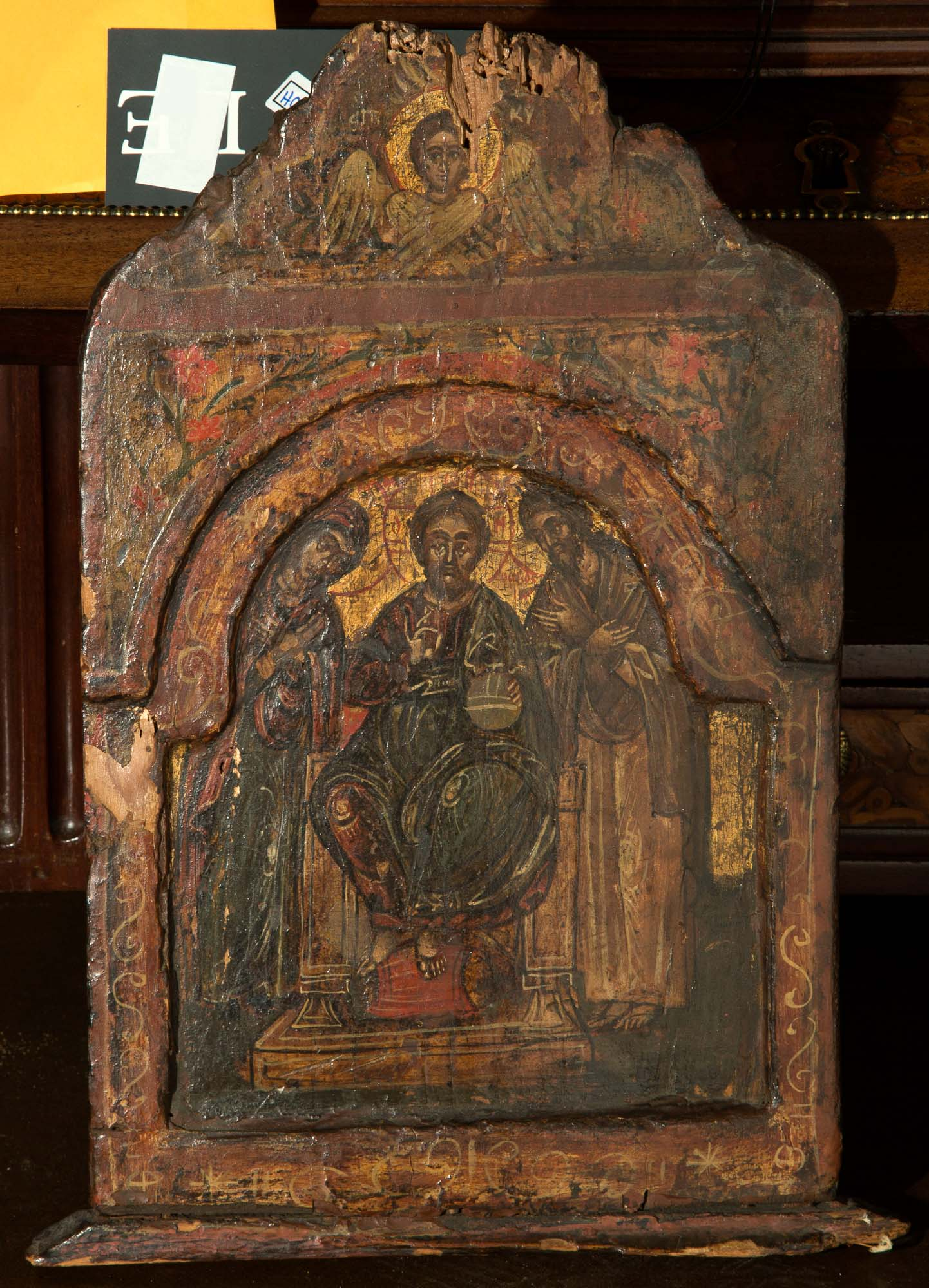 Lot image - Painted and Giltwood Triptych Icon of Christ Pantocrator, the Mother of God and St. John the Baptist