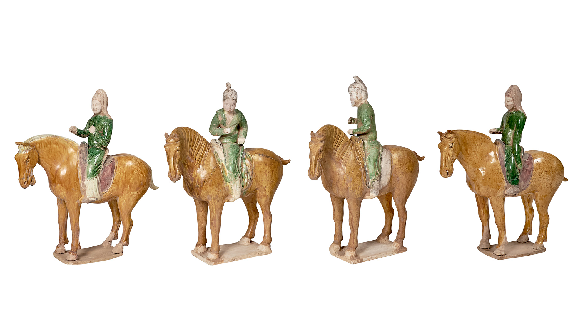 Lot image - Group of Four Chinese Glazed Pottery Mounted Horses