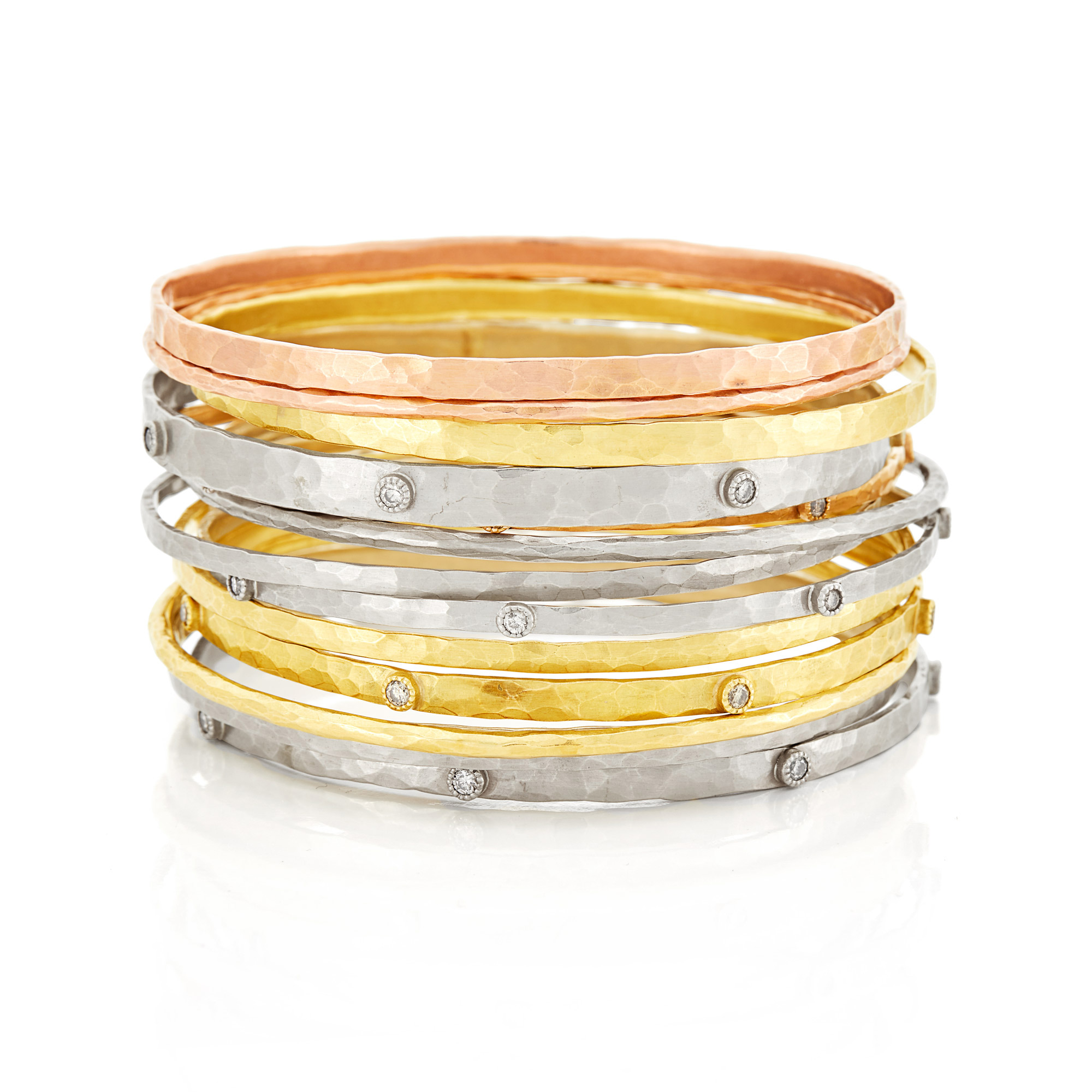 Lot image - Thirteen Tricolor Hammered Gold and Diamond Bangle Bracelets