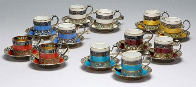 Set of Ten Russian Gilt Silver, Cloisonne, Guilloche and Plique a Jour Demitasse Cups, Saucers and Spoons; Together with a Similar Pair