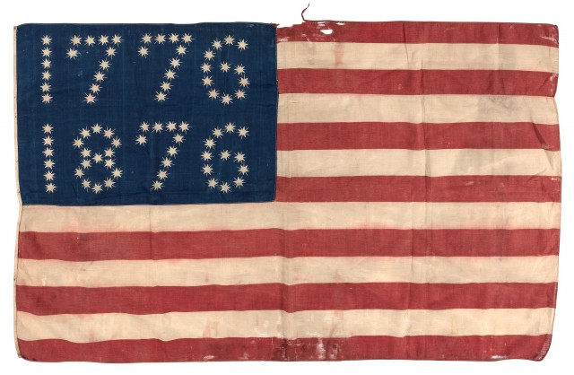 [AMERICAN FLAG] Centennial American parade flag with stars arranged in the...