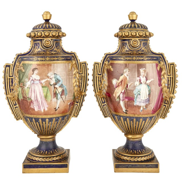 Pair of Sévres Style Gilt and Polychrome Decorated Porcelain Covered Urns