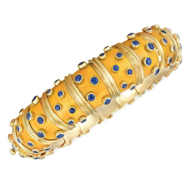 Gold, Orangy-Yellow Paillonne Enamel and Sapphire Bangle Bracelet, Tiffany and Co., Schlumberger, France