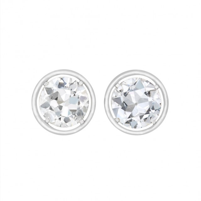Pair of Silver, White Gold and Diamond Stud Earrings