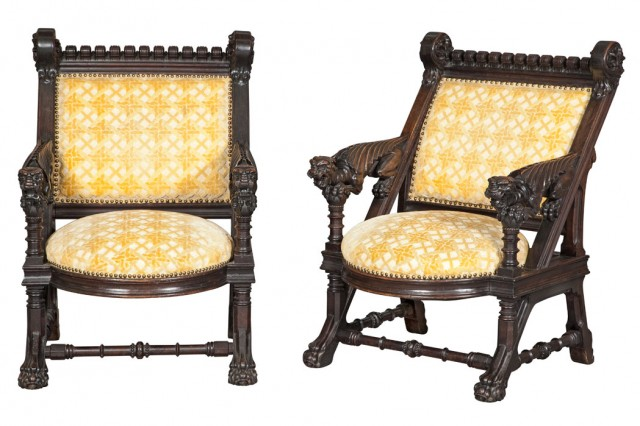 Pair of American Modern Gothic Carved and Dark Stained Upholstered Armchairs