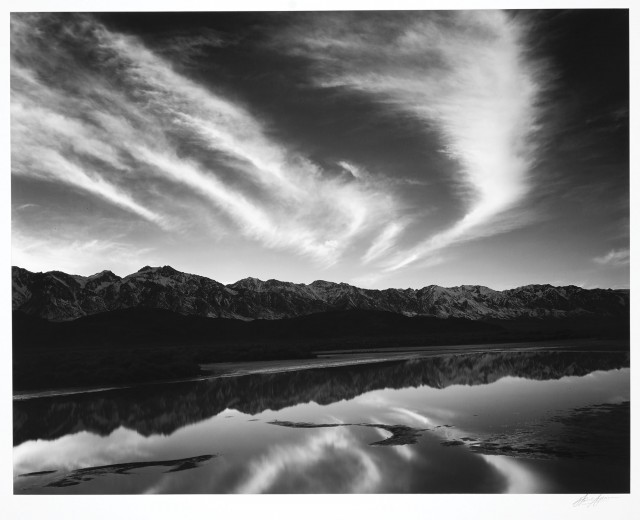 ADAMS, ANSEL (1902-1984)  Evening Clouds and Pool, East Side of the Sierra from the Owens Valley, California,