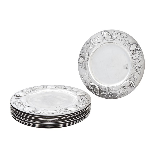 Set of Twelve English Sterling Silver Chargers    Gilbert Marks, London, 1897  Each circular, the border embossed with floral specimen and incised signature and date 1898.  Diameter 8 5/8 inches, total approximately 122 ounces.