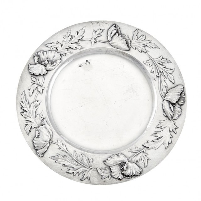 Set of Twelve English Sterling Silver Chargers    Gilbert Marks, London, 1897  Each circular, the border embossed with floral specimen and incised signature and date 1898.  Diameter 8 5/8 inches, total approximately 124 ounces.