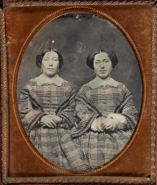 [DAGUERREOTYPE--TWINS]  Group of two daguerreotypes of female twins.