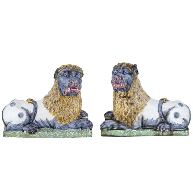 Pair of Continental Faience Figures of Recumbent Lions