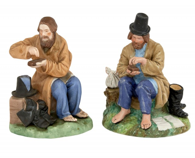 Two Russian Porcelain Figures of Peasant Men Stopping for Lunch