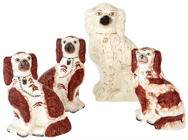 Group of Four Staffordshire Pottery Figures of Seated Spaniels