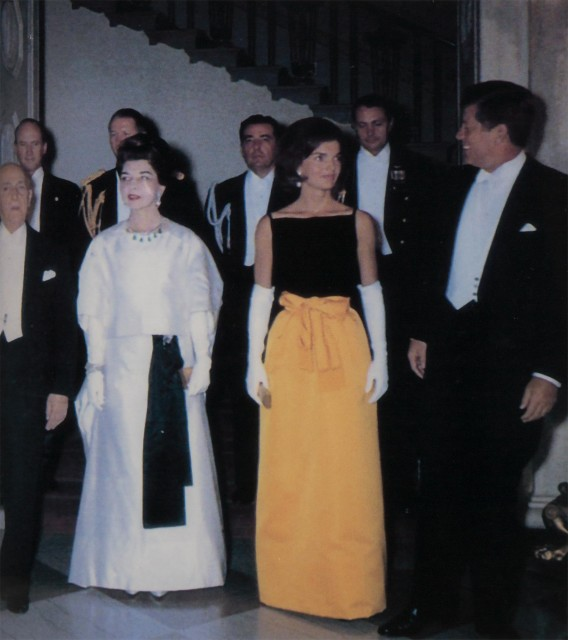 [OLEG CASSINI GOWNS]  Group of approximately eight Oleg Cassini designed gowns and dresses, including two replicas of a gown made for Mrs. Kennedy as First Lady.