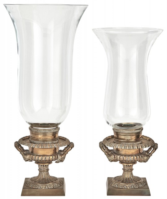 Assembled Pair of Bronze and Glass Hurricane Lamps   D>  Each urn base with mask handles. Height of larger 17 1/4 inches (43.8 cm).