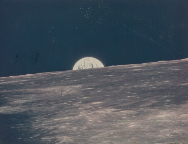 [SPACE PHOTOGRAPHY]  COLLINS, MICHAEL. Group of 10 small format photographs of the earth, moon and the landing module taken July 20, 1969 during the Apollo 11 mission, with negatives.