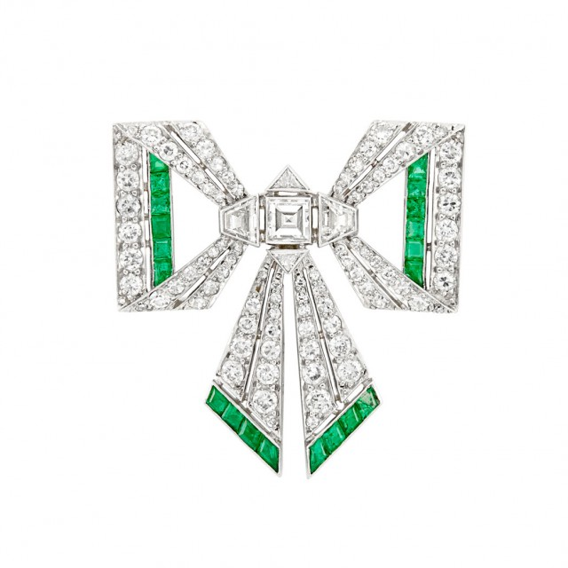 Platinum, Diamond and Emerald Bow Pin, France, circa 1920. Sold for $3,438.