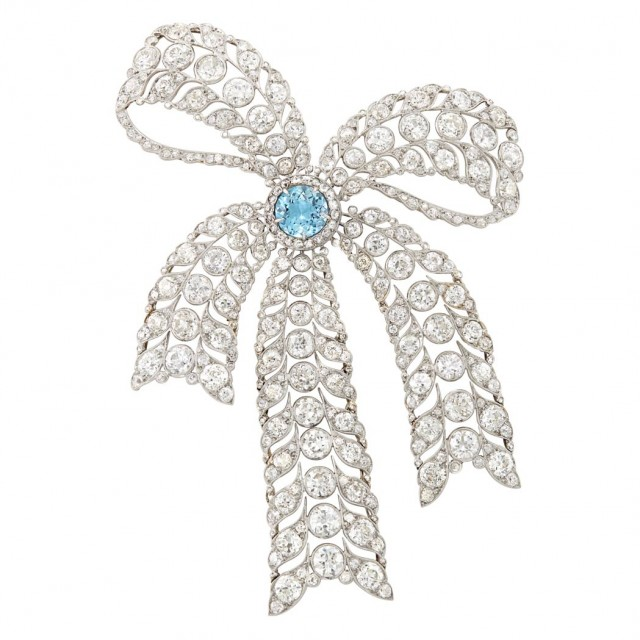 Belle Epoque Platinum, Gold, Aquamarine and Diamond Bow Brooch. Sold for $31,250.