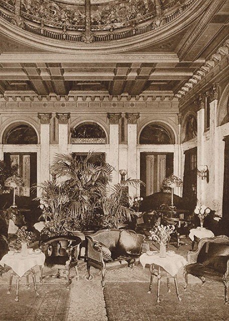 Interior view of the Hotel Manhattan's Palm Court, or Tea Room, circa 1917. Two oversize Tiffany table lamps are seen on the tables at the rear.