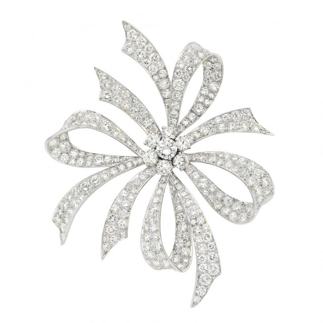 Platinum and Diamond Bow Clip-Brooch, Van Cleef & Arpels. Sold for $31,250.