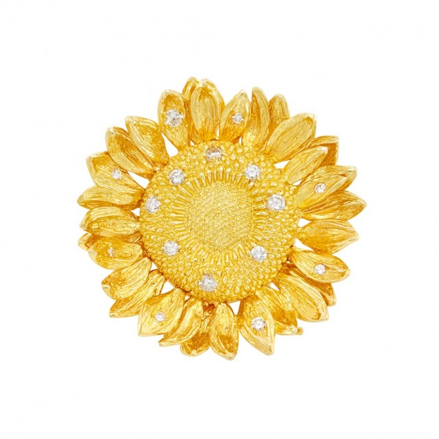 Lot 475. Gold and Diamond Sunflower Pendant-Brooch, Asprey. Est. $800-1,200
