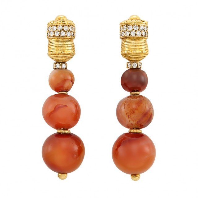 Lot 652. Pair of Gold, Diamond and Carnelian Bead Pendant-Earclips, Boucheron, France. Est. $3,000-4,000