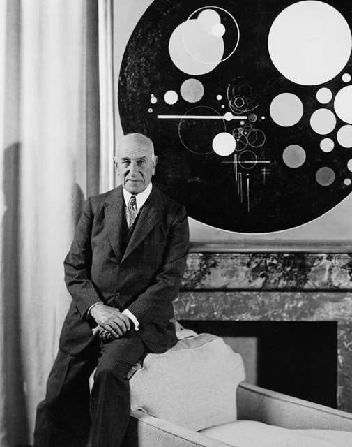 Solomon R. Guggenheim at the Plaza Hotel, New York, ca. 1937, with Rudolf Bauer's Andante (from Tetraptychon: Symphony in Four Movements, 1926–30) Photo: Underwood and Underwood Studios, New York, courtesy HvRF Archives
