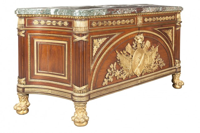 Louis XVI Style Gilt-Bronze Mounted Mahogany, Kingwood and Rosewood Marble Top Commode à Vantaux, After a model by Guillaume Benneman and Joseph Stöckel, late 19th/early 20th century. Lot 447.