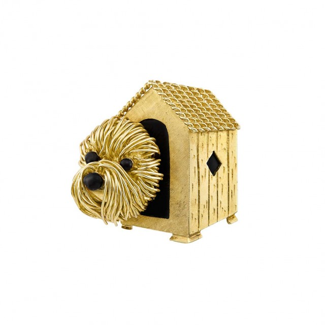 Gold and Black Enamel Brooch, Van Cleef and Arpels. Sold for $11,250.