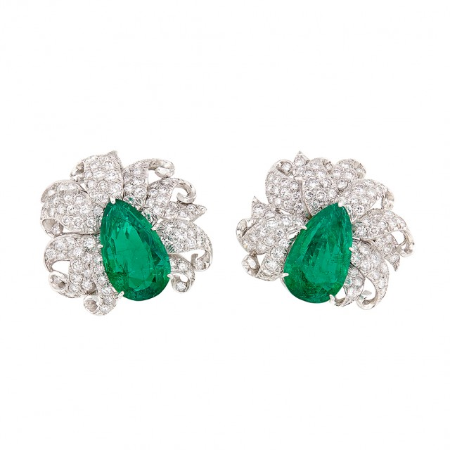 Pair of Platinum, Emerald and Diamond Earclips, circa 1960. Est. $45,000-65,000. Lot 517. Auction Oct 18