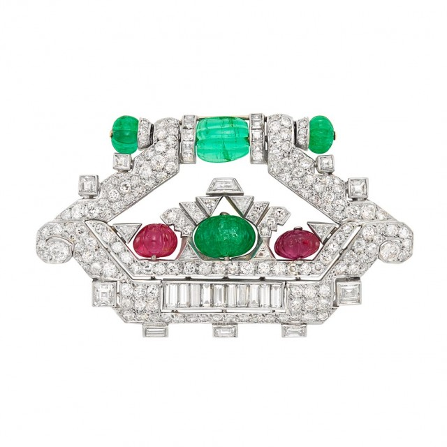 Art Deco Platinum, Diamond, Carved Emerald and Ruby Bead and Diamond 'Tutti Frutti' Brooch, Mauboussin, France, circa 1925. Sold for $22,500.