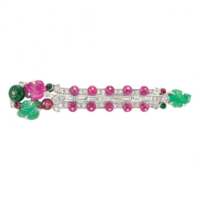 Art Deco Platinum, Diamond, Carved Emerald and Ruby and Ruby Bead 'Tutti Frutti' Barrette, by Cartier, circa 1925. Lot No. 425. Sold for $59,375.