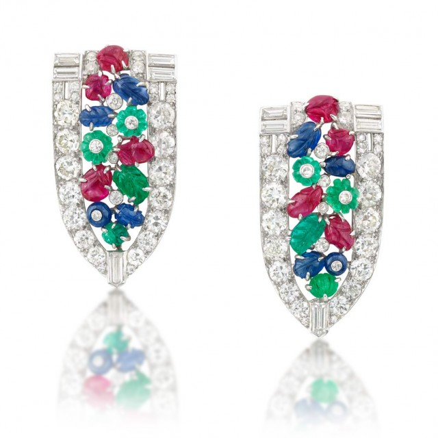 Pair of Platinum, Diamond and Carved Colored Stone 'Tutti Frutti' Clips, Ross-Pennell, circa 1930. Sold for $25,000.