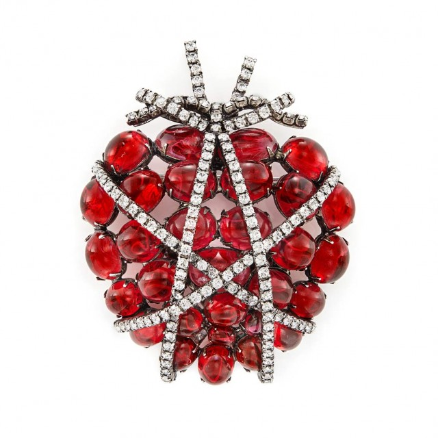 Metal, Cabochon Red Glass and Rhinestone Heart Brooch, Iradj Moini. Sold for $1,500.