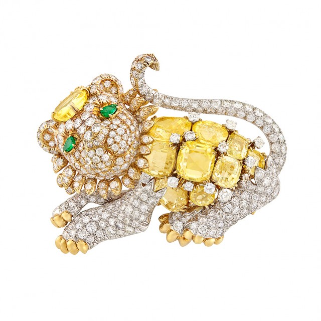 Gold, Platinum, Yellow Sapphire, Diamond and Emerald Lion Clip-Brooch, David Webb. Est. $30,000-50,000. Sold for $56,250.