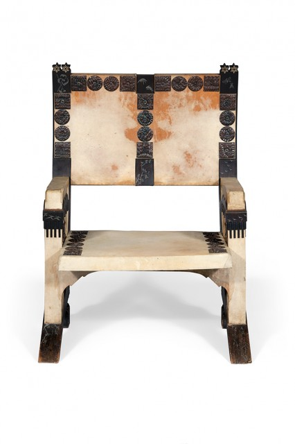 Carlo Bugatti Parchment, Ebonized Wood, Copper, Pewter and Inlaid Bone Armchair. Est. $8,000-12,000. Lot 157. Auction June 6.