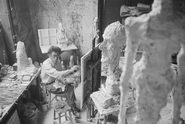 Alberto Giacometti painting in his Paris studio, 1958