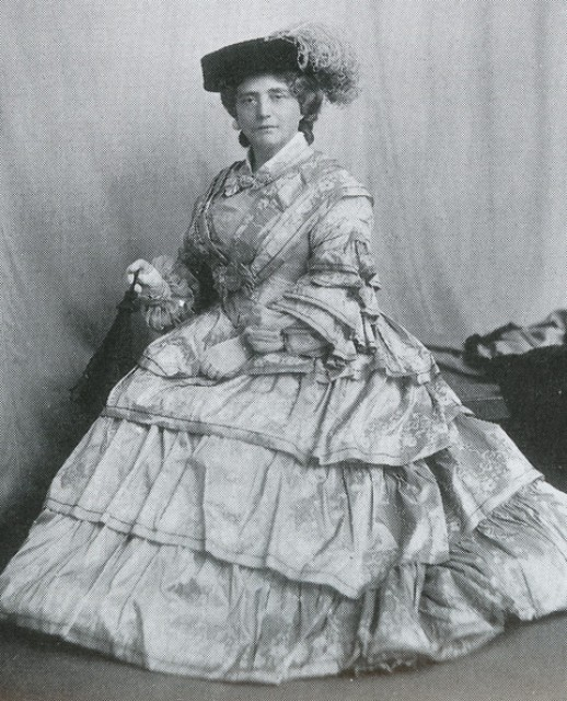 Miss Kate Cranston, circa 1903, dressed in the fashion of the 1850s.
