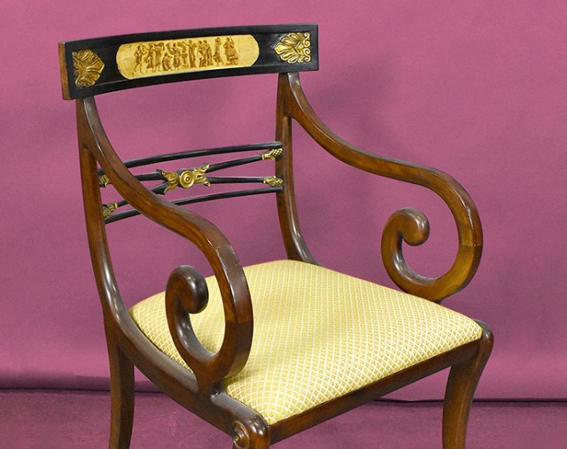 One of a set of three regency style mahogany chairs