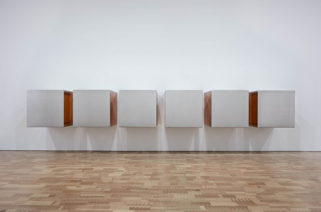 Donald Judd. Untitled. 1968. Stainless steel and amber Plexiglas; six units, each 34 × 34 × 34″ (86.4 × 86.4 × 86.4 cm), with 8″ (20.3 cm) intervals. Overall: 34 × 244 × 34″ (86.4 × 619.8 × 86.4 cm).