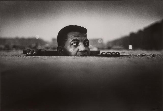 Gordon Parks (1912-2006), Emerging Man, Harlem, 1952. Est. $1,500-2,500. Lot 111. Photographs. Auction June 29.